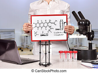 Medical researcher woman holding clipboard with drawing ...