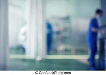 Medical room in the hospital with working personnel, unfocused background
