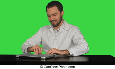 Medical Staff Doctor Wait Patient Start Work Day on a Green Screen, Chroma Key. Professional shot on BMCC RAW fith high dynamic range. You can use it e.g in your commercial video, commercial video, medical ,video about clinic, doctor, health, hospital, medicine.