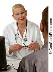medical staff in conversation with a patient