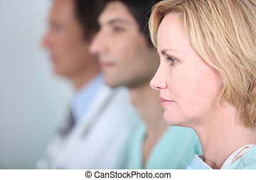 Medical staff in line