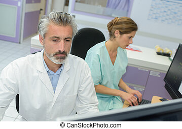 medical staff in office using computers
