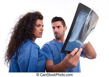Medical staff looking at x-ray