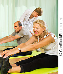 Medical staff with senior people at gym - Medical staff at...