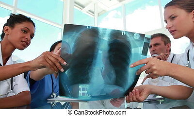 Medical staff working on a chest radiography