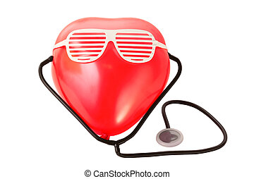 Medical stethoscope and red balloon heart with white plastic glasses isolated on white