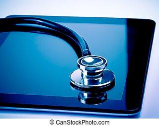 medical stethoscope on modern digital tablet in laboratory