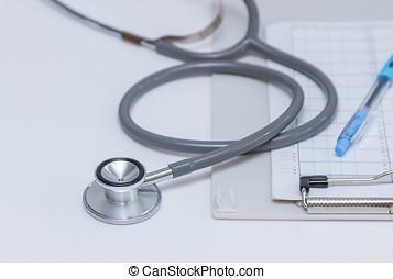Medical stethoscope on white background.