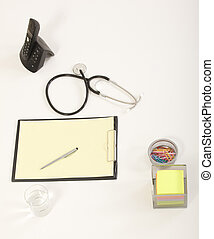Medical Stethoscope with Pen on Medical File Folders
