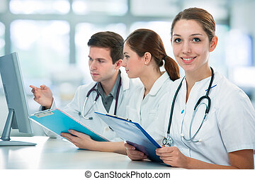 Medical students - group of medical students studying in...