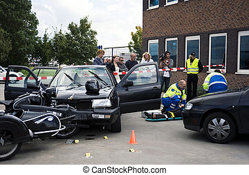 car crash - Medical support team assists a victim on a...