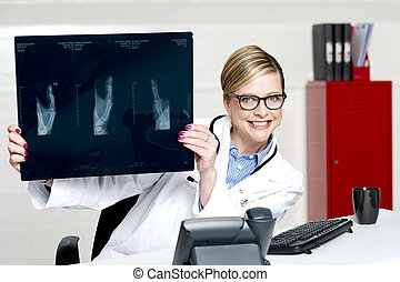 Medical surgeon expert holding x-ray report