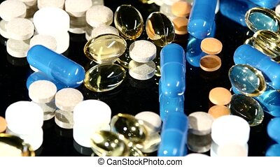 Medical tablets, pills and capsules, rotation, reflection, close up