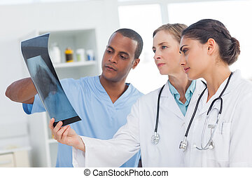 Medical team analysing an x-ray in a hospital
