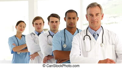 Medical team crossing arms