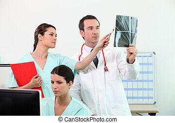 Medical team discussing an xray