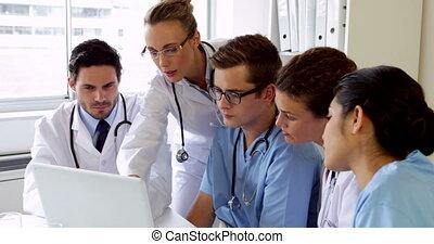 Medical team having a meeting looki
