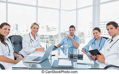 Medical team in a bright meeting room - Smiling medical team...