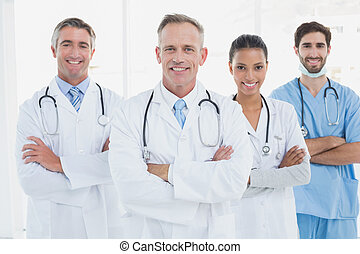 Medical team looking at camera