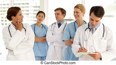Medical team looking at camera at the hospital
