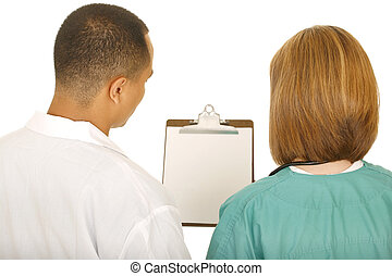 Medical Team Looking At Clip Board