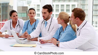 Medical team looking at laptop