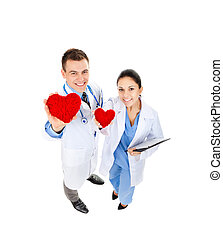 medical team doctor man and woman happy smile hold red heart. Full length portrait top angle view isolated over white background