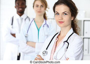 Medical team of confident doctors ready to help. Medicine and health care, insurance concept