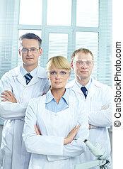 Medical team - Portrait of three doctors in uniform looking...