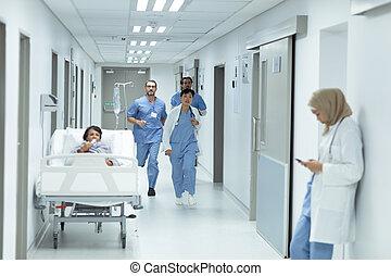 Medical team running in the corridor at hospital