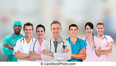 Medical team standing arms crossed in line