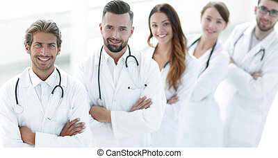 medical team standing with arms crossed on a white background