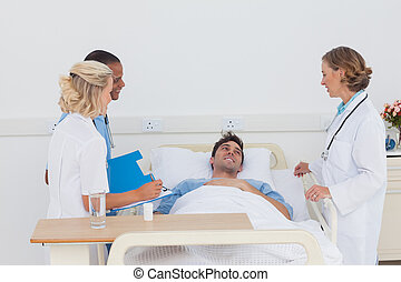 Medical team taking care of a sick patient