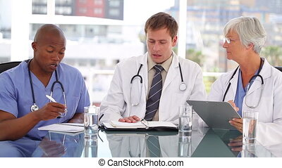 Medical team talking to each other