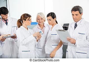 Medical Team Working - Medical team working in laboratory