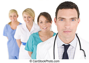 Medical Teamwork - A male doctor with his team of colleagues...