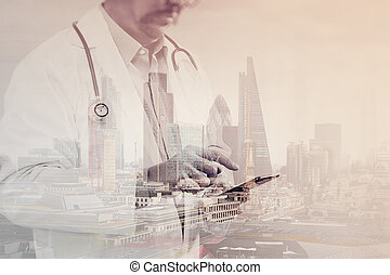 Double exposure of Medical technology concept. Doctor hand working with modern smart phone with medical chart interface, multi channel connection, London buildings