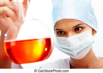 Medical test - Portrait of scientist holding medical tube...
