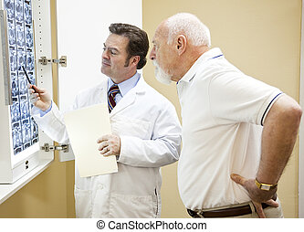 Medical Test Results - Doctor explains a CT scan of the...