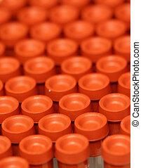 Medical Test Tubes - orange medical test tubes for testing...