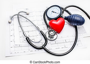 Medical tools lying on ECG - Stethoscope and blood pressure ...