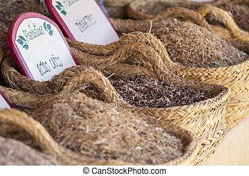 Medical, wicker baskets stuffed medicinal healing herbs