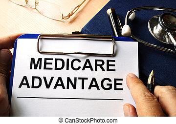 Medicare advantage in a clipboard. Health care insurance...