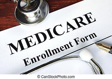 Medicare enrollment form written on a paper. Medical...