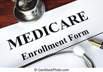 Medicare enrollment form written on a paper. Medical...