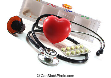 Medication - Stethoscope with heart and pills on a white...