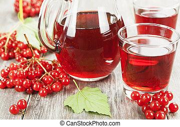 Medicinal drink fresh viburnum in the jug