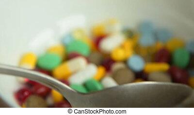 Medicine abuse metaphor - Close-up shot of taking spoonful...