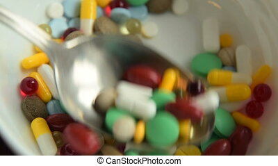 Medicine abuse shown as eating pills - Close-up shot of...