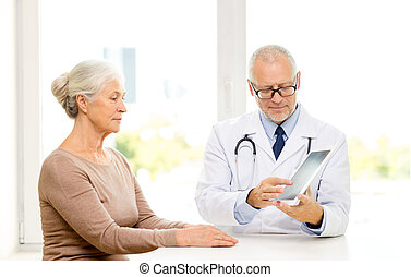 senior woman and doctor with tablet pc
